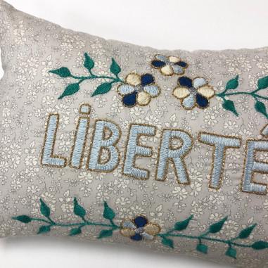Embroidered cushion LIBERTE